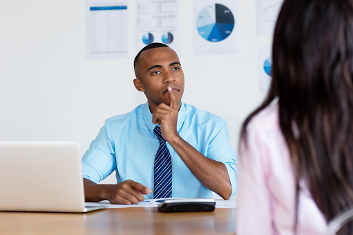 istock African american businessman listening to employee 1131377987