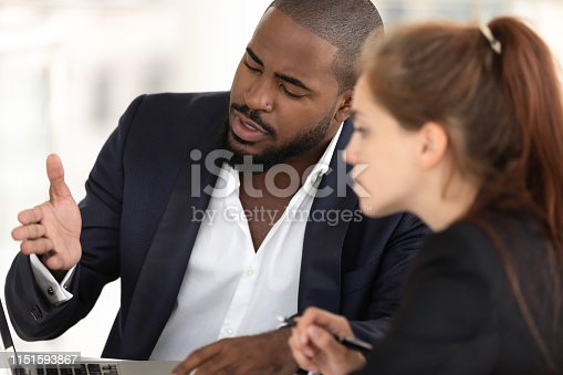 1031235468 istock photo African american businessman mentor teaching caucasian intern with computer 1151593867