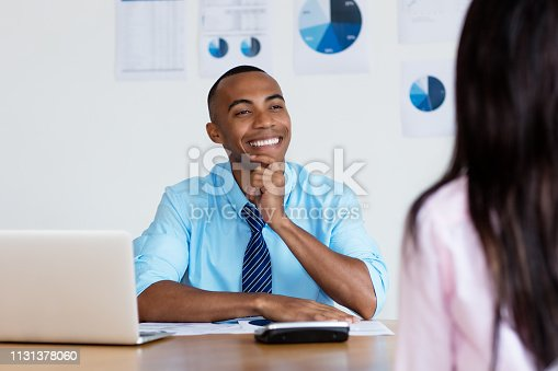 istock African american businessman talking with client 1131378060