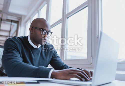 istock African american businessman working on his laptop 465102236