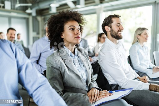istock African American businesswoman and her colleagues on a seminar. 1151763700