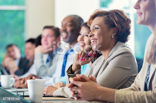 istock African American businesswoman attending seminar or job training business conference 477815144