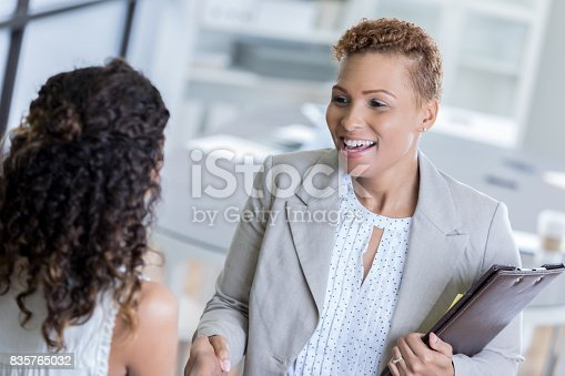 istock African American businesswoman greets client 835765032