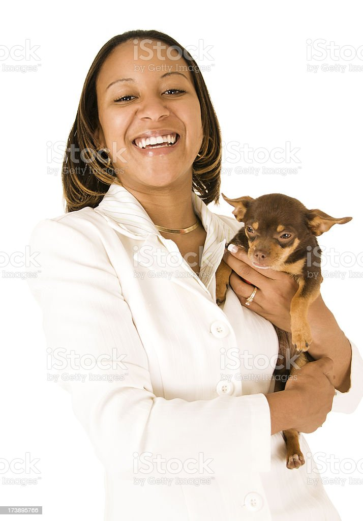 African American Businesswoman holding dog royalty-free stock photo