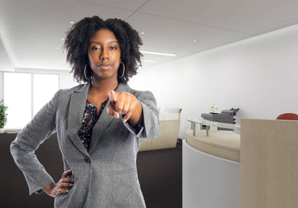 African American Businesswoman in an Office Pointing Forward stock photo
