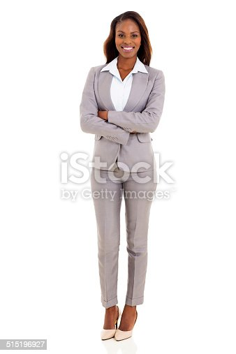 happy african american businesswoman with arms crossed