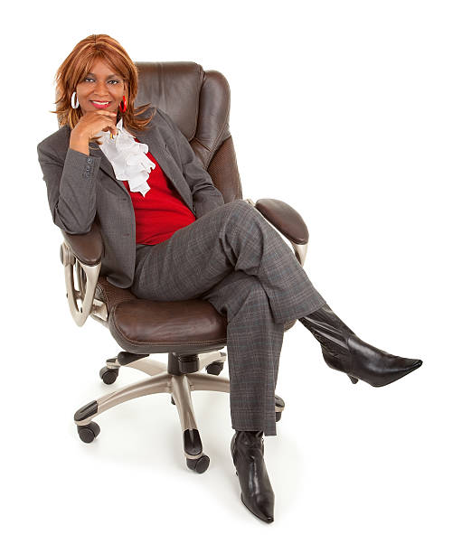 African American Businesswoman Sitting on a Leather Chair stock photo