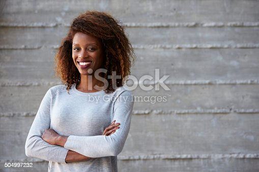 istock African American Businesswoman Standing Against Office Wall 504997232