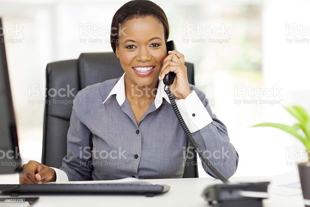 african american businesswoman using landline phone royalty-free stock photo