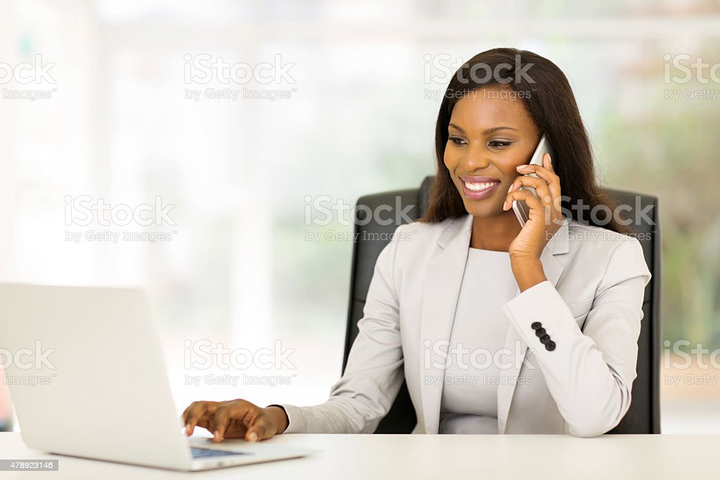 african american businesswoman using mobile phone stock photo