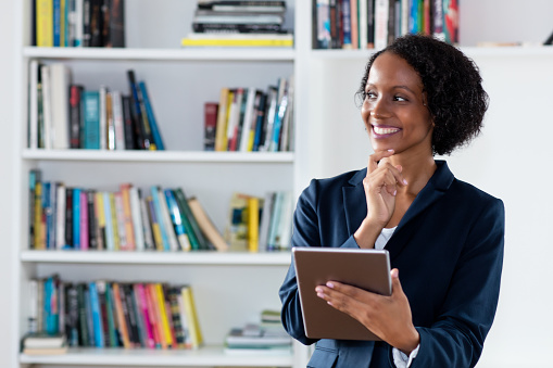 istock African american businesswoman with digital tablet 1146929116