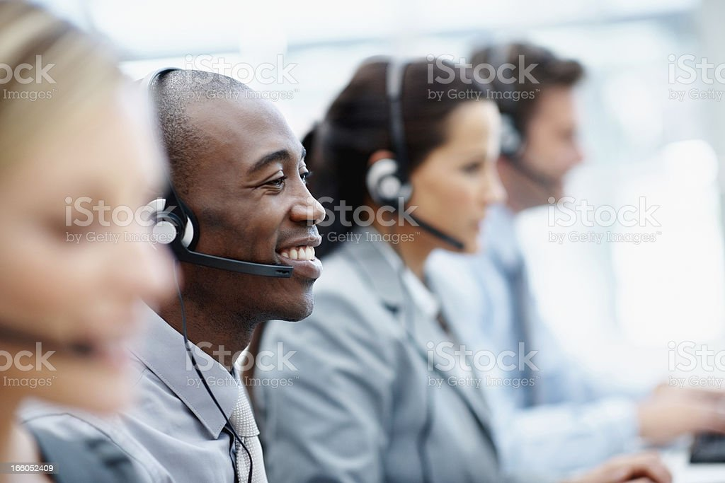 African American call centre employee with colleagues at work royalty-free stock photo