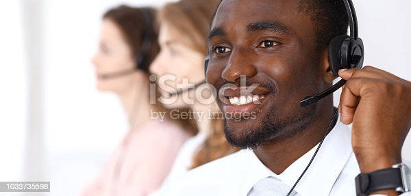 istock African american call operator in headset. Call center business or customer service concept 1033735598