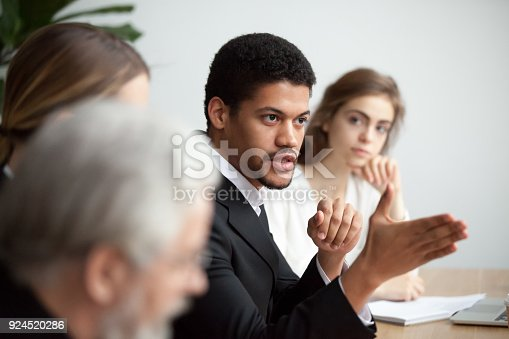 istock African american ceo talking giving instructions at diverse team meeting 924520286