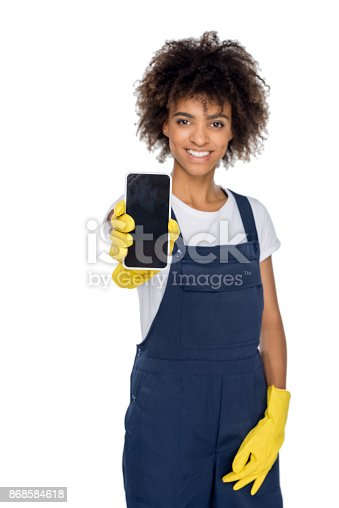 istock african american cleaner with smartphone 868584618