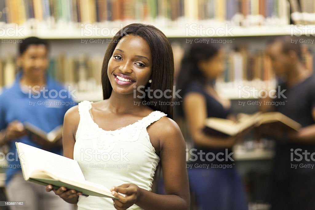 african american college girl in library royalty-free stock photo