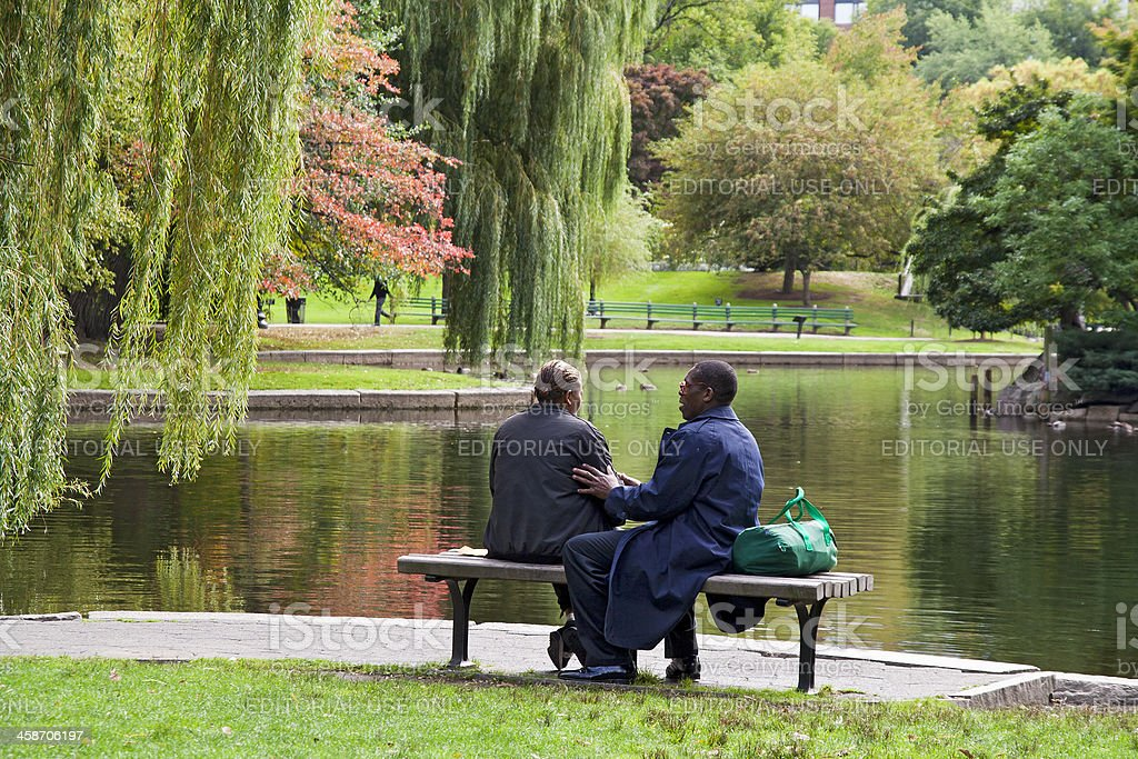 African American couple by the pond in Boston Common stock photo