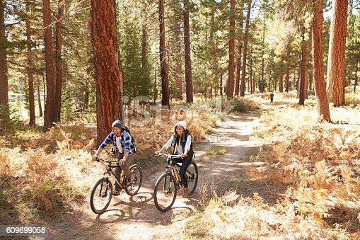 istock African American Couple Cycling Through Fall Woodland 609699058
