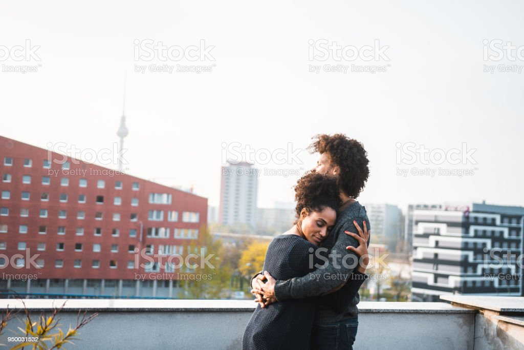 African American couple embracing each other on the rooftop African American couple embracing each other on the rooftop 30-39 Years Stock Photo