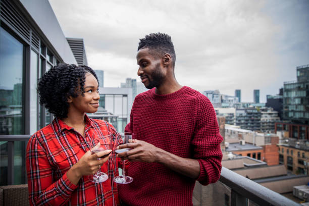African American Couple Enjoying Some Wine and the View From Their Balcony stock photo
