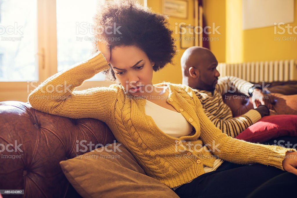 African American couple having relationship difficulties at home. stock photo