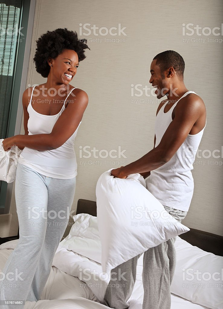 African American Couple in a Pillow Fight royalty-free stock photo