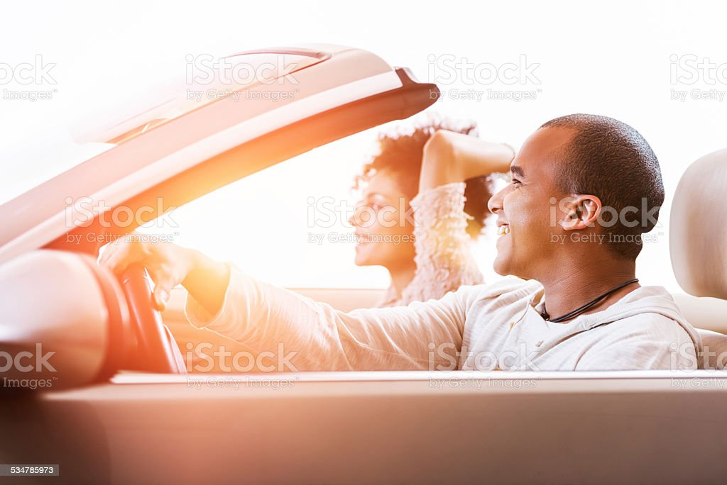 African American couple in convertible car. stock photo