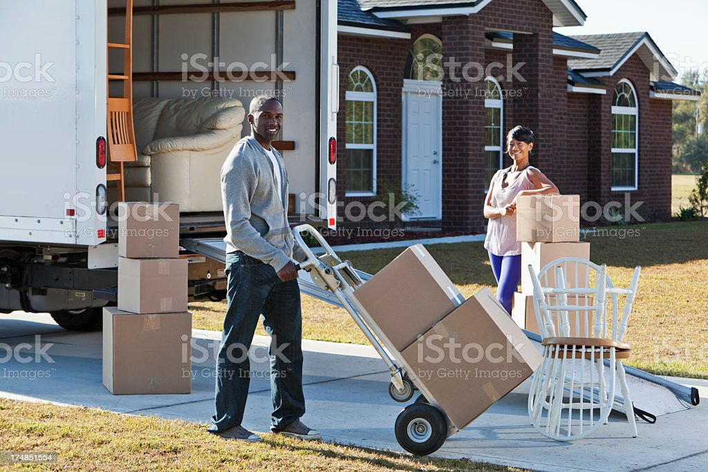 African American couple moving house stock photo