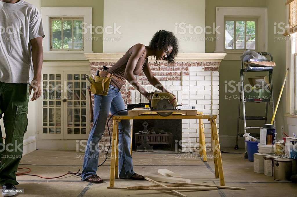African American couple renovating home interior. stock photo