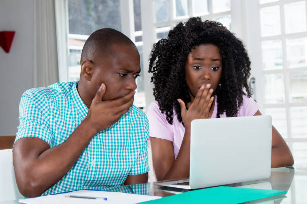 African american couple shocked about computer virus and identity theft African american couple shocked about computer virus and identity theft at desk at home identity theft stock pictures, royalty-free photos & images