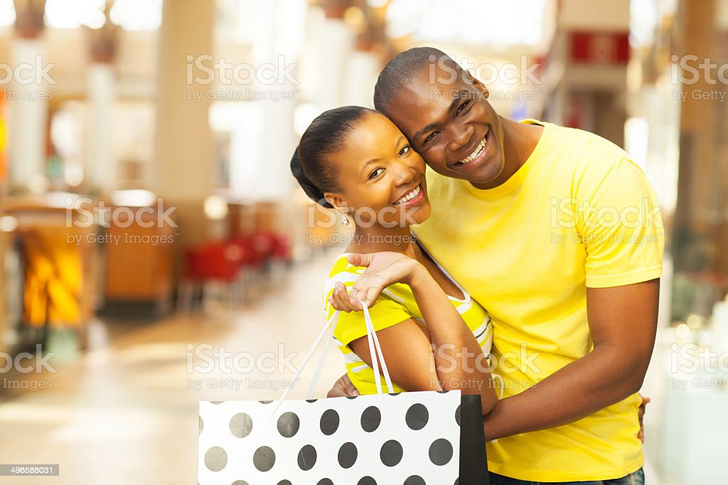 african american couple shopping stock photo