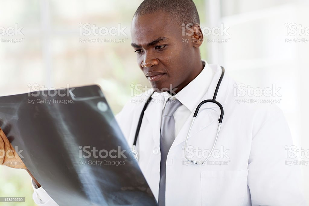 african american doctor looking at patient's x-ray royalty-free stock photo