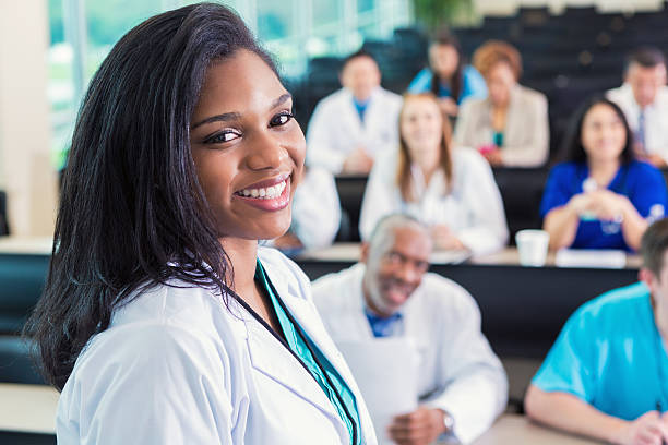 African American doctor or medical professional attending healthcare conference stock photo