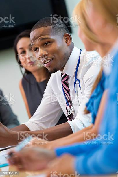 African american doctor talking to colleagues in hospital staff picture id530983121?b=1&k=6&m=530983121&s=612x612&h=iwj1ko2wmfuj8 x1itx6rymrv13ngsdnq9szs8afaxc=