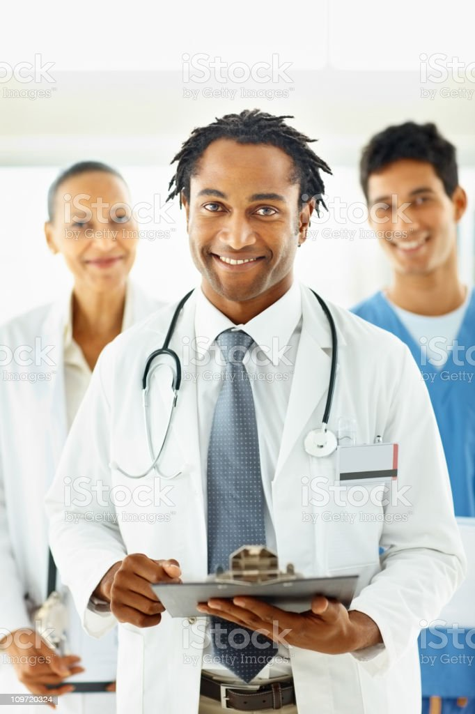 African American doctor with colleagues at the back royalty-free stock photo