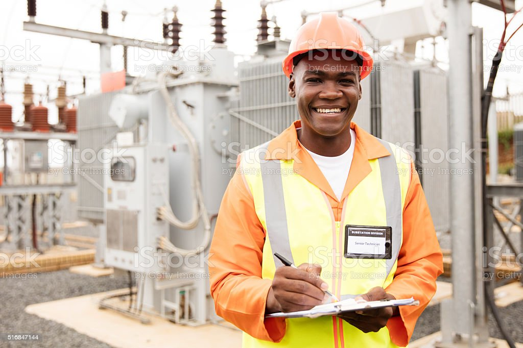 african american electricity company worker stock photo