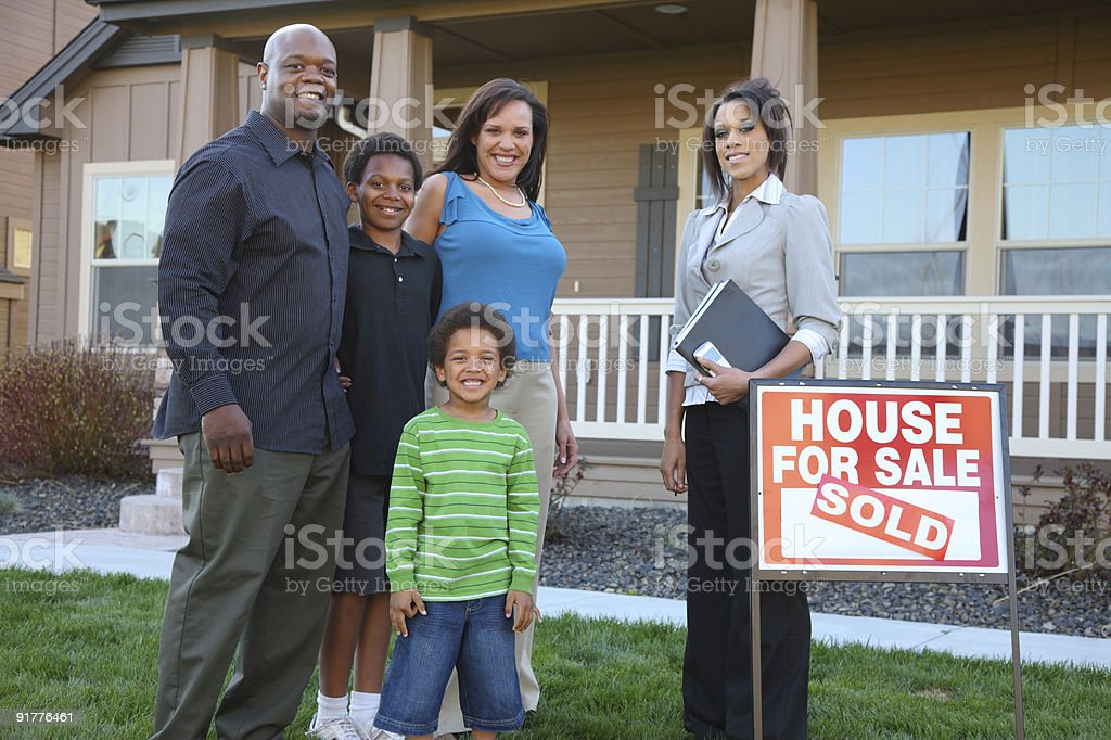 African American family and Realtor royalty-free stock photo