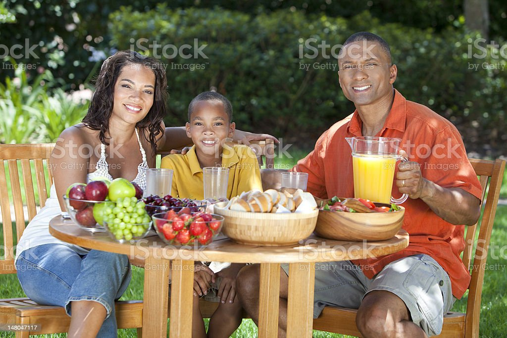 African American Family Eating Healthy Food Outside royalty-free stock photo