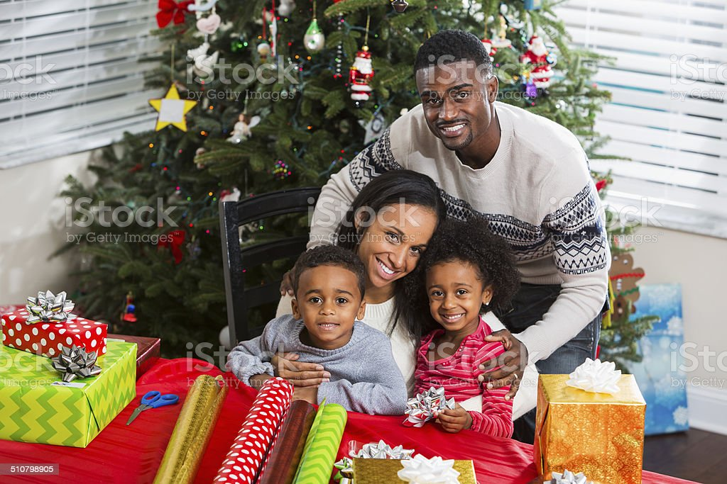 African American Family Getting Ready For Christmas Wrapping Gifts ...