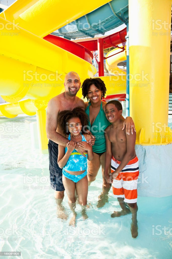 African American family having fun at water park stock photo