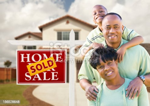 istock African American Family in Front of House and Sold Sign 156528648