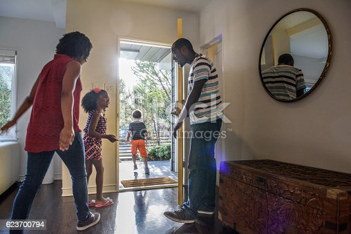 istock African American family leaving the house, father holding door 623700794