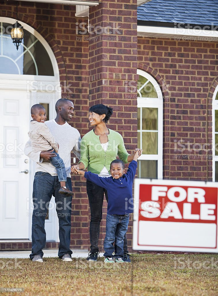 African American family looking at house for sale stock photo