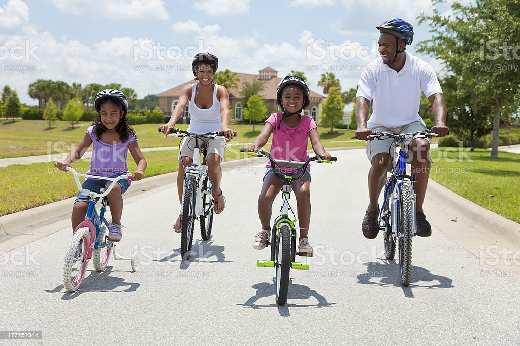 African American Family Parents and Children Cycling stock photo