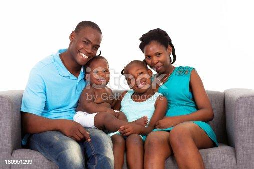 1126155137 istock photo african american family sitting on sofa 160951299