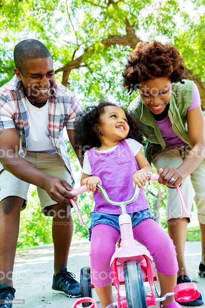 African American family spend time in the park stock photo