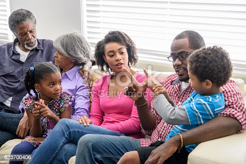 istock African American family spending quality time together at home 623700406