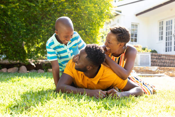 African American family spending time together in their garden. stock photo