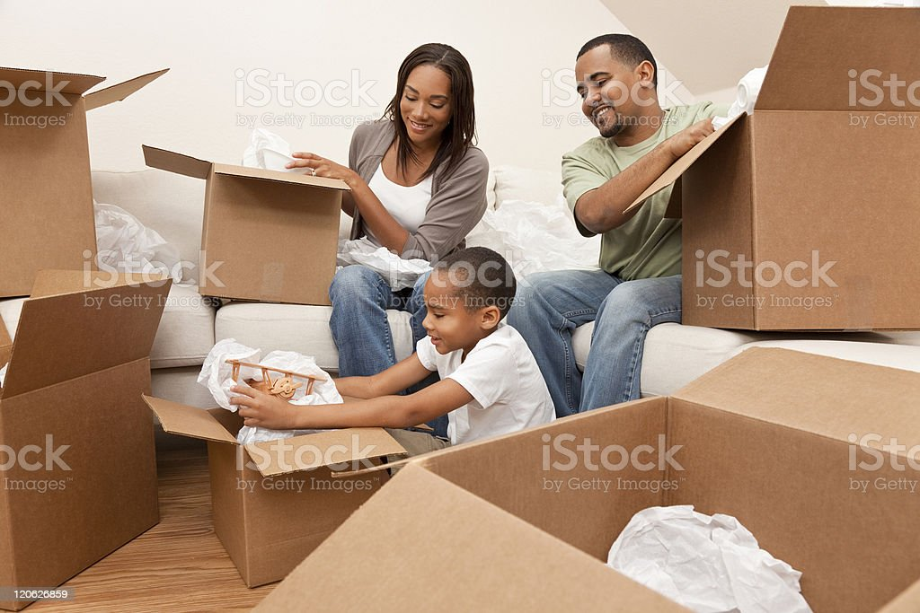 African American Family Unpacking Boxes Moving House stock photo
