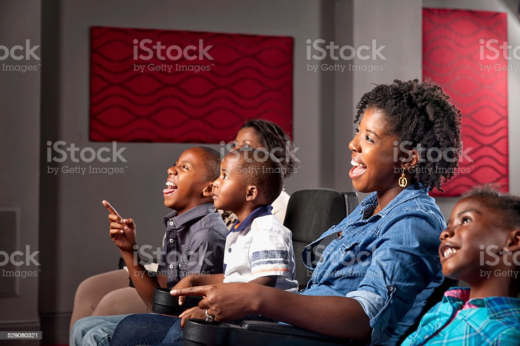 African American Family Watching Movie stock photo